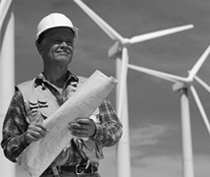 Man working by wind turbine