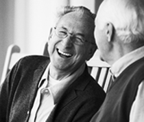Photo of two elderly gentlemen laughing